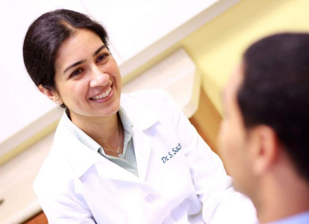 Dr Sachar with patient - NYC Dentist